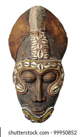 Genuine expressive African mask showing a typical face.Wood and leather materials, with shells decor.
