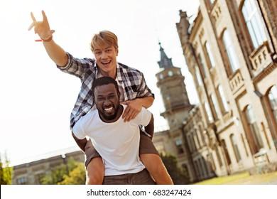 Genuine goofy guy having fun with his friend