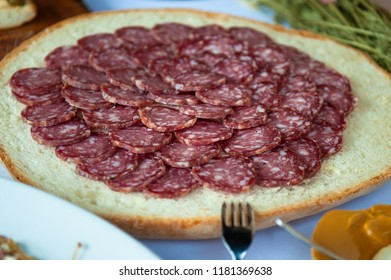 Genuine Italian salami as an appetizer at a party.