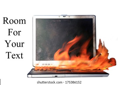 A Genuine Laptop Computer on fire. Isolated on white with room for your text. Represents Computer Damage, Insurance Claims, Fire Danger, Work Protest, Burning up the internet, Hot Chat and E Mails etc