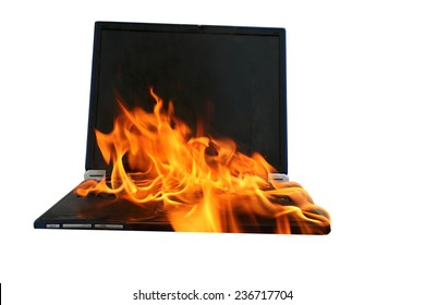 a Genuine Laptop Computer on fire. Isolated on white with room for your text. Represents Hot Love, Burning up the Internet, Setting the World on Fire, Computer Damage, Insurance claims, Hell Fire etc.