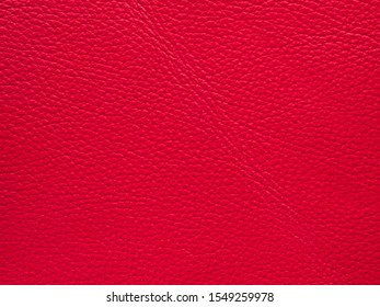 Genuine light red full grain cow skin leather luxury texture cowhide background