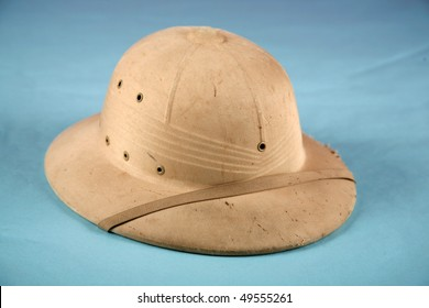 """A Genuine """"pith helmet"""" also known as the """"safari helmet"""" """"sun helmet""""  topee, """"sola topee""""  salacot or topi on a blue background"""