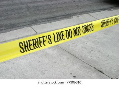 """Genuine """"Sheriff's Line Do Not Cross"""" caution tape collected from the scene of a murder."""