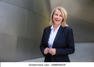 Genuine sincere portrait of a beautiful experienced business woman, investor, professional attire