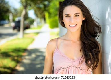 Genuine sincere smile from young healthy happy and cheerful female in suburban neighborhood