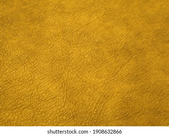 Genuine yellow cattle leather texture background. Macro photo