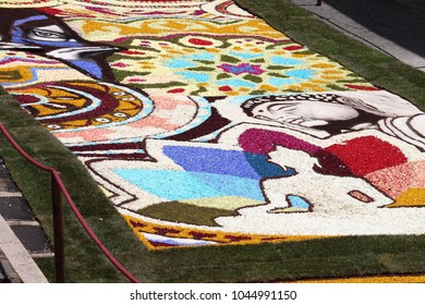 GENZANO, ITALY - JUNE 18: Floral Carpet in the Main Street on June 18, 2017 in Genzano, Italy. This event takes place every year and almost 350.000 flower petals were used this year