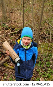 geocaching boy finds a well camouflaged cache in the forest