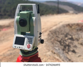 Geodetic total station on the construction site against blurred background