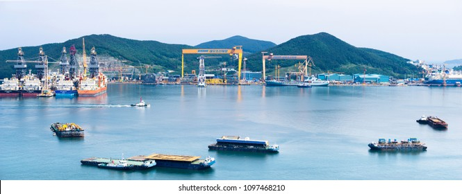 GEOJE ISLAND, SOUTH KOREA - MAY 20, 2018 : Bay of Daewoo Shipbuilding and Marine Engineering (DSME) in Okpo city, The bay consists of Marine engineering facilities, ships and off shore platforms