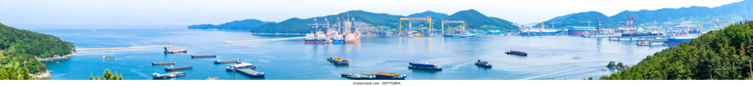 GEOJE ISLAND, SOUTH KOREA - MAY 13, 2018 : Bay of Daewoo Shipbuilding and Marine Engineering (DSME) in Okpo city, The bay consists of Marine engineering facilities, ships and off shore platforms