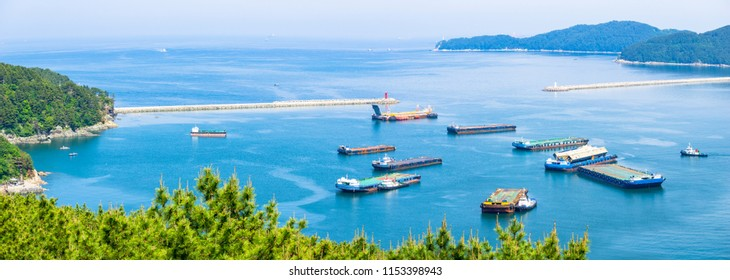 GEOJE ISLAND, SOUTH KOREA - MAY 13, 2018 : Mouth of the Bay of Daewoo Shipbuilding and Marine Engineering (DSME) in Okpo city, The bay consists of many kind of ships in marine engineering Industries.