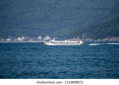 GEOJE, SOUTH KOREA - APRIL 28, 2018 : White  Geoje Island ferry sails along in the sea. This ship services between geoje island and Oedo island.