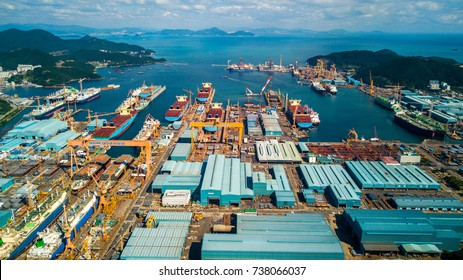 Geoje, South korea - September 2017 : High angle view of Daewoo shipyard in okpo city, South korea. Scenery consist of shipyard inside the bay, commercial ship, platform, heavy crane and building.