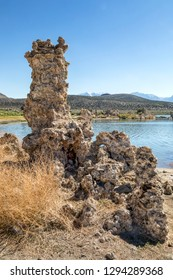 Geologic formations called tufa towers rise up on the shores of Mono Lake, California.