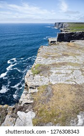 The geological features of the karst landscape on Inis Mor of the Aran Islands Ireland along the Wild Atlantic Way at Dun Aengus. The seaside cliff is 100 meters above the North Atlantic.