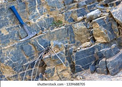 Geological hammer on the rocks