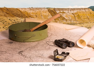 Geological scientific expedition on the background of work tools and minerals.