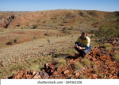 Geologist Examining a Banded Iron Formation- Pilbara - Australia