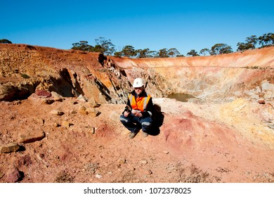 Geologist in Open Pit Mine