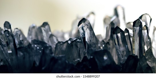 Geology of beauty. Natural transparent cosmic wild jewels through the light. Texture of gemstone rhinestone clear closeup as a part of cluster geode filled with rock Quartz crystals.