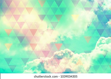 Geometric, abstract background with futuristic triangles and natural, colorful clouds in the sky
