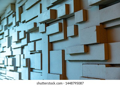 Geometric abstract background in shades of light blue. Three-dimensional grunge backdrop with parallelogram and cube forms in perspective view. Geometry of even and straight rectangular shapes.