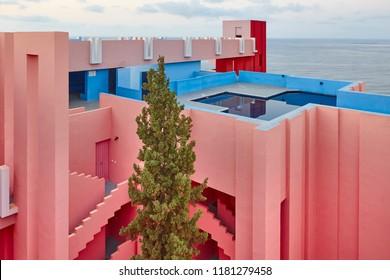 Geometric building design. The red wall, La manzanera. Calpe, Spain