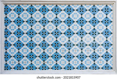 A geometric ceramic tile mosaic as typically found on the frontages of traditional chinese peranakan shop houses in Asia