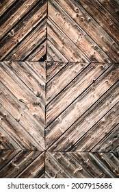 Geometric closeup of natural aged and rural rustic wood surface of recycled weathered planks constructed in creative, decorative lines, old vintage wooden background or backdrop with space for text.