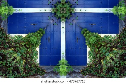 geometric composition of blue door, typical constructions of white houses in the town of Ibiza, indigo and green leafy plants surrounding the door, narrow streets and charming Mediterranean style,