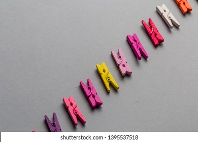 Geometric composition of clothespins, top view , copy space. line of creative colorful clothespins