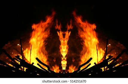Geometric composition of fire, The witch who hides in the fire, unreal view of the feast of San Juan, traditional bonfire of San Juan,witch figure out the flames, Galicia Spanish festivals