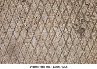 Geometric diamond pattern of concrete pavement. Vertical diamond shape. Abstract texture background