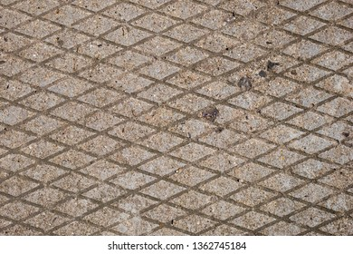 Geometric diamond shape pattern of concrete pavement. Horizontal diamond form. Abstract texture background