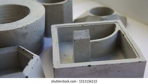 Geometric empty flower pot made of concrete. Gray cement pot for planting succulents and cacti. Hobbies, home decor.