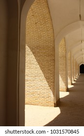Geometric hallway in natural colors and central perspective. Taken in Rajastan, India.