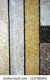 Geometric mosaic detail: neutral colors