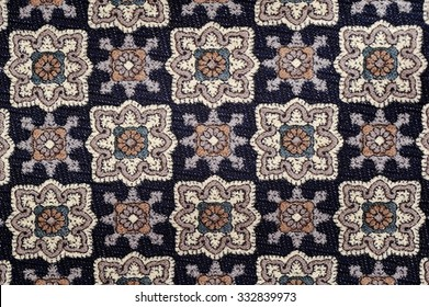 Geometric pattern embroidered on fabric