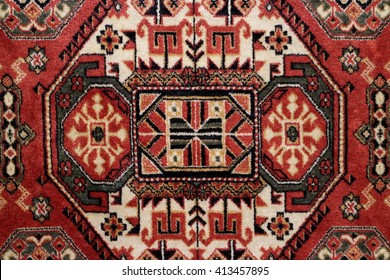 geometric  pattern old Persian carpet closeup