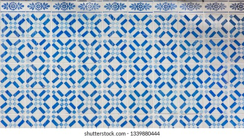 Geometric patterned Portugese tiles texture with floral border tiles