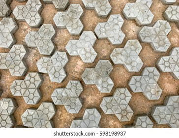Geometric paving stones made out of concrete spread out on a gravel drying bed
