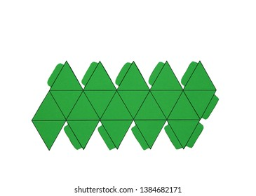 Geometric shape cut out of paper and photographed on white background. Geometry net of platonic solids Icosahedron. 2-dimensional shape that can be folded to form a 3-dimensional shape or a solid.