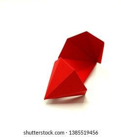 Geometric shape cut out of red paper and photographed on white background. Geometry net of Hexagonal Dipyramid. 2-dimensional shape that can be folded to form a 3-dimensional shape or a solid.