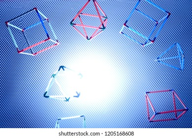 Geometric shapes against a cool blue frosted lit background