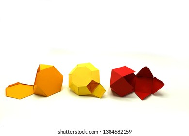 Geometric shapes cut out of paper and photographed on white background. Geometry net of Hexagonal Dipyramid. 2-dimensional shape that can be folded to form a 3-dimensional shape or a solid.