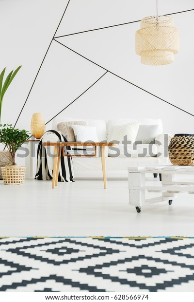Geometric shapes on white wall in black and white lounge