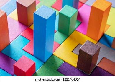 Geometric shapes on a wooden background, close-up. The concept of logical thinking