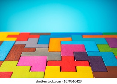 Geometric shapes on a wooden background. The concept of logical thinking.